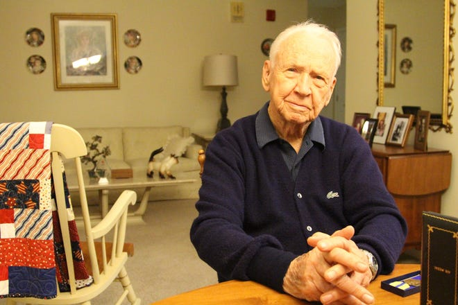 Charles Allen sits inside his Delaware home on Tuesday. Turning 100 in November, the World War II aviator said he would like to be in the cockpit one last time.