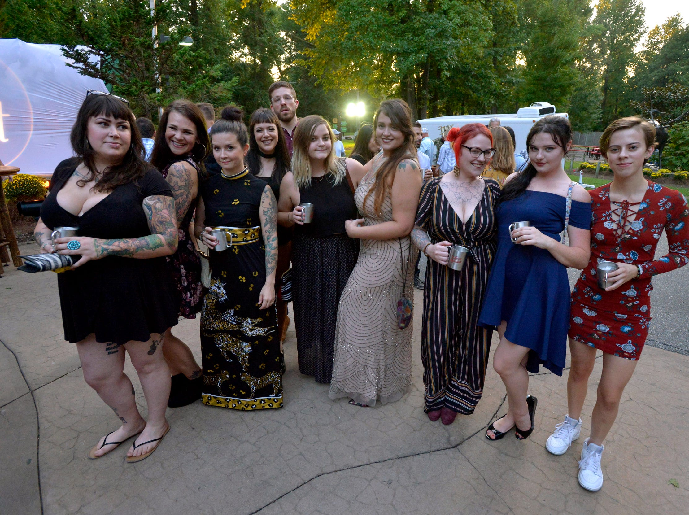 September 13, 2018 - Representatives with So Fresh and So Green housekeeping pose for a photo during the 2018 Memphis Most awards party at Teton Trek in the Memphis Zoo. (Brandon Dill for The Commercial Appeal)