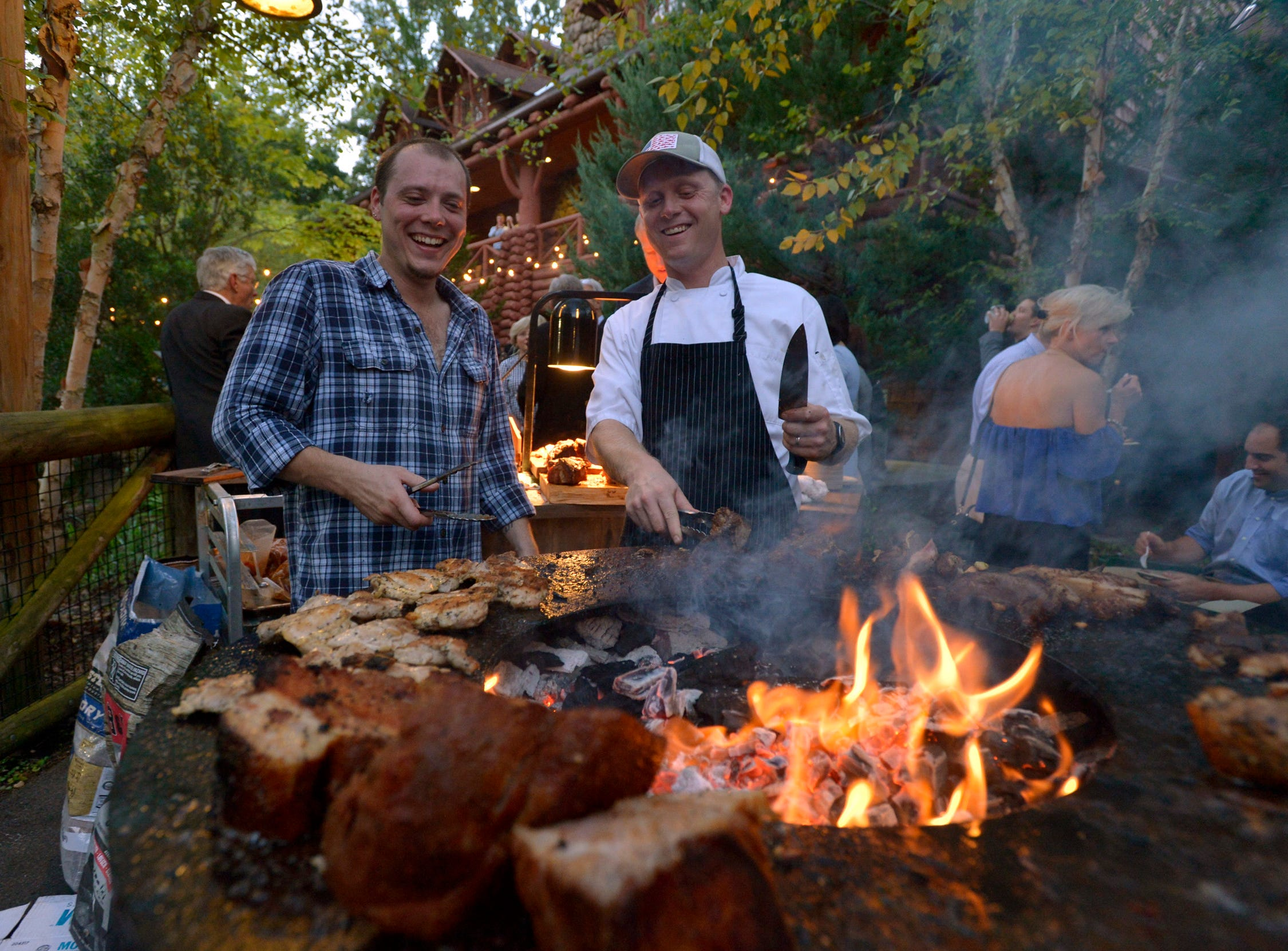 September 13, 2018 - Ronny Roberson, left, and Jordan Buchanan, with Paradox Catering, grill meat during the 2018 Memphis Most awards party at Teton Trek in the Memphis Zoo. (Brandon Dill for The Commercial Appeal)