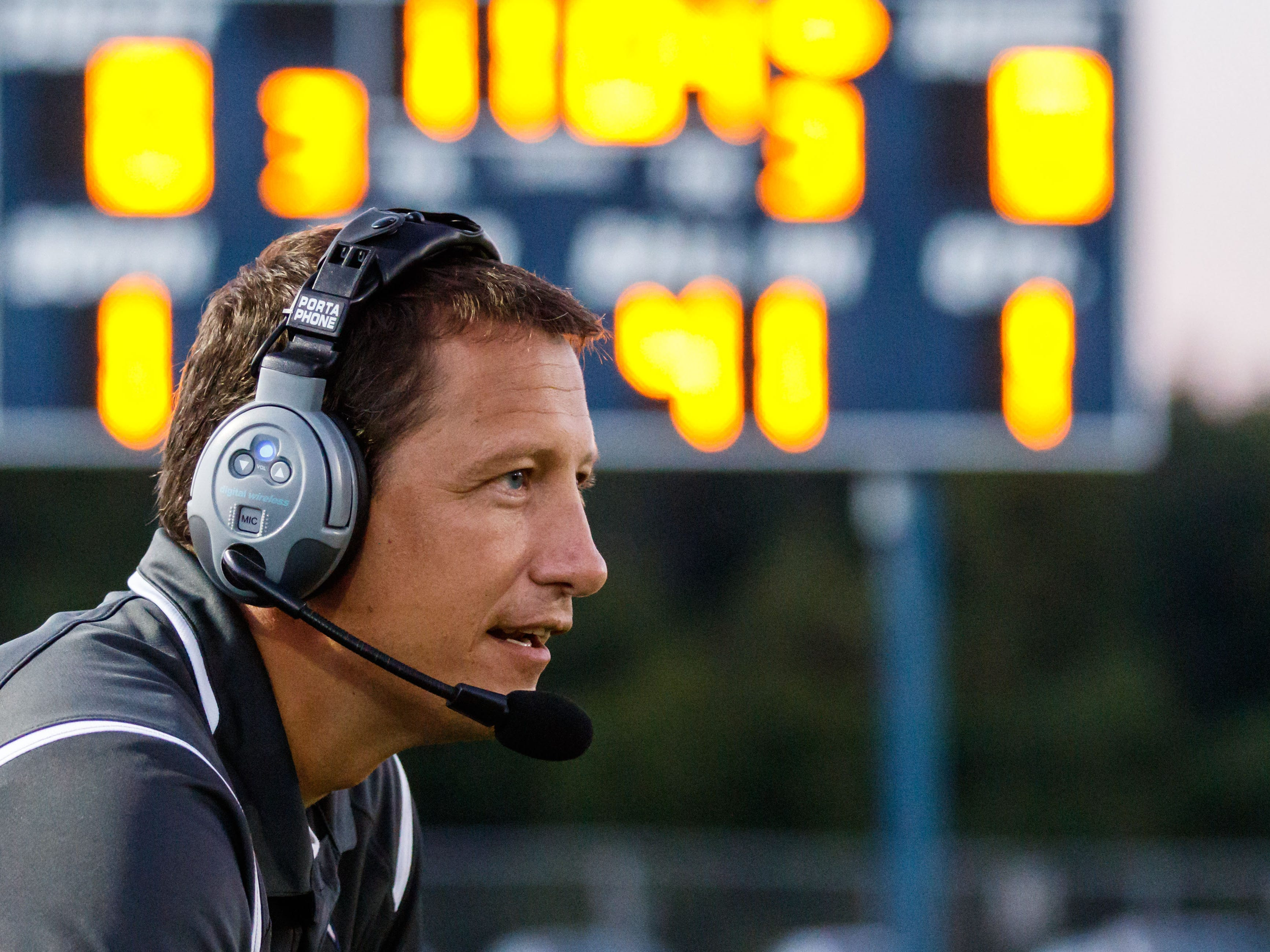 Lake Country Lutheran head coach Greg Brazgel keeps a watchful eye on the action during the game at home against University School of Milwaukee on Thursday, Sept. 13, 2018.