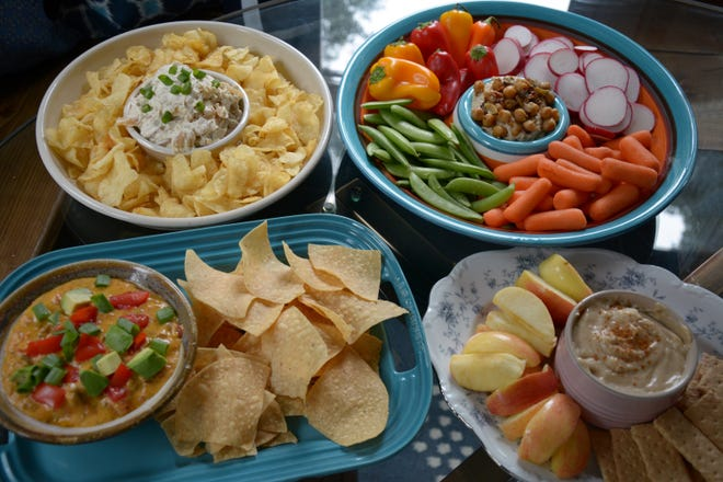 Vidalia onion dip, hummus with spicy chickpeas, taco queso dip and caramel apple dip add up to a fun fall party spread.