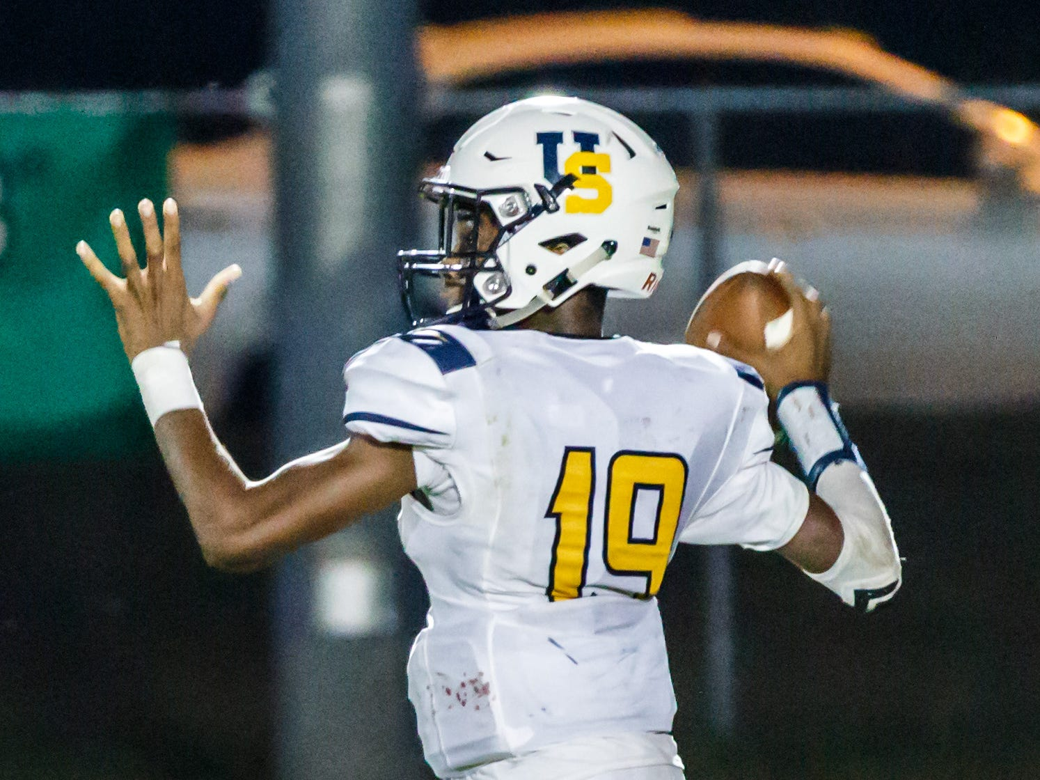 University School quarterback CJ Boyd (19) looks to pass as he scrambles out of the pocket during the game at Lake Country Lutheran on Thursday, Sept. 13, 2018.