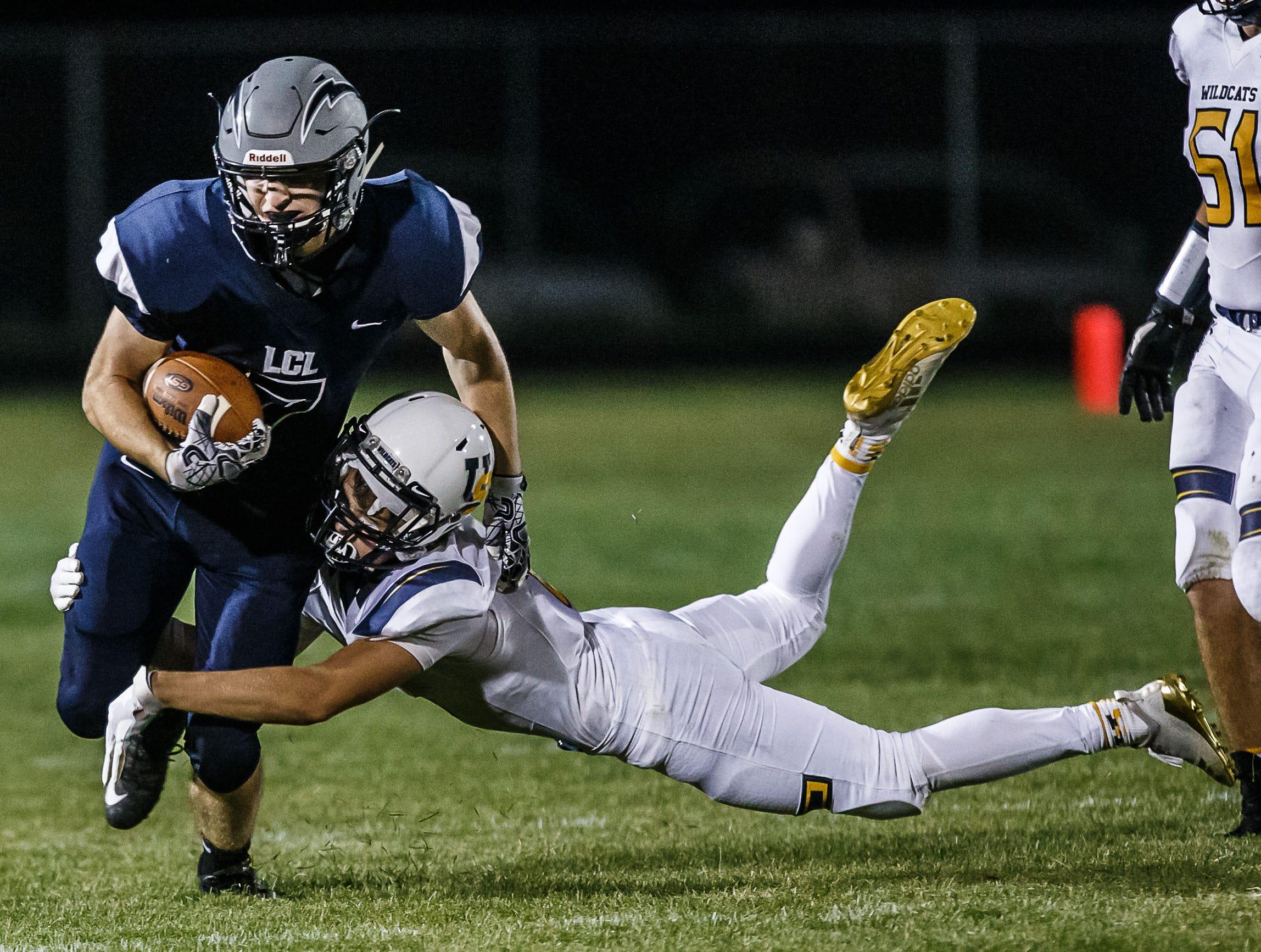 University School linebacker Gordy Leech (8) wraps up Lake Country Lutheran's Dane Vance (7) during the game at Lake Country Lutheran on Thursday, Sept. 13, 2018.