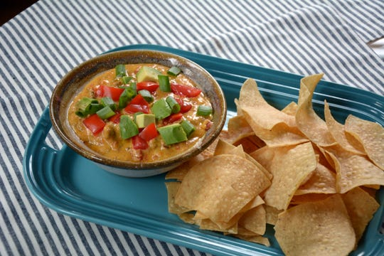 The slow cooker makes easy work of this taco queso dip.