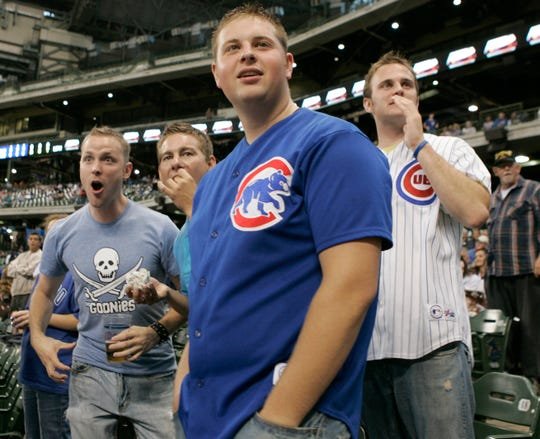 (from left) Dennis Miller, 26, from Chicago, Darren Edmark, 31, from Chicago, Andrew Savage, 21, from Bristol, WI, and Micha Thoman, 23, from Chicago, cheer the Cubs' batting practice before the Cubs-Astros game at Miller Park on Sunday, Sept. 14, 2008.  Fans arrived by the thousands to enjoy the game under the roof on Sunday.