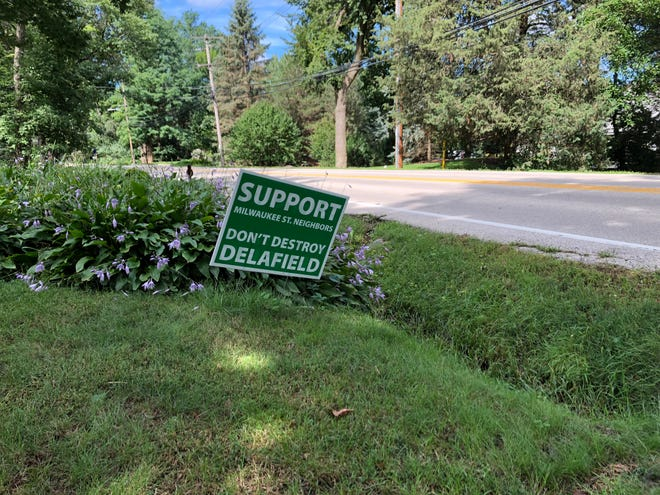 A sign along Milwaukee Street in Delafield shows that not all residents are in favor of a $500,000 proposal to widen a portion of the street.