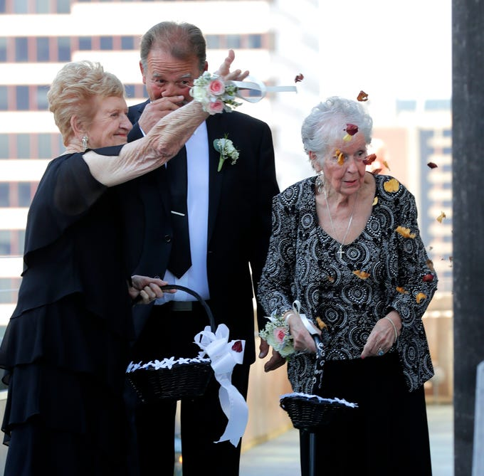 Shelby Pecor married John Klein at Hotel Metro Friday and their grandmothers, DeAnna Klein, left,  and Joan Pecor, served as the flower girls. The petals they tossed were from roses sent to one of the ladies from her late husband.