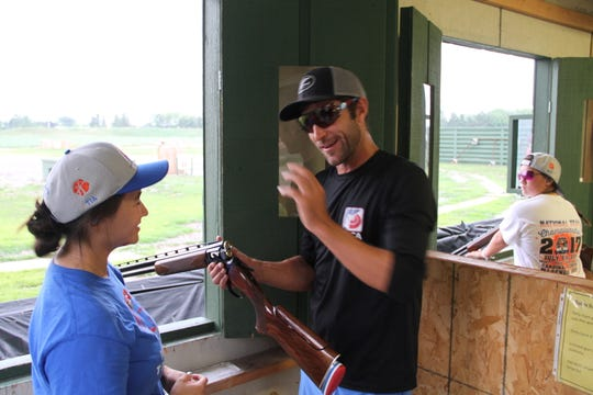 Brad Kidd, a national sporting clays champion, shares pointers with youth trapshooters at Waukesha Gun Club in Waukesha, Wisconsin.