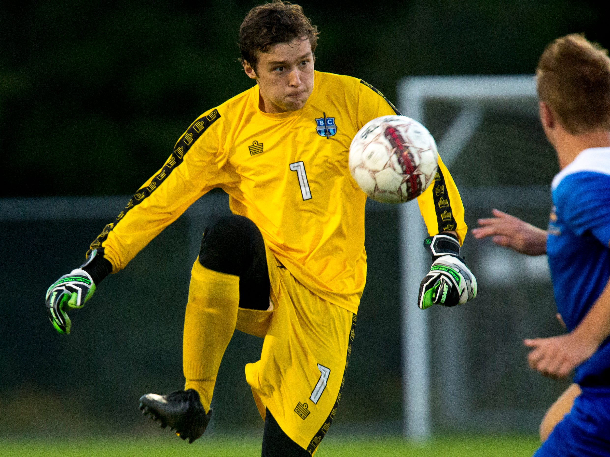 Brookfield Central's Daniel Yurk deflects the ball at Germantown on Sept. 13.