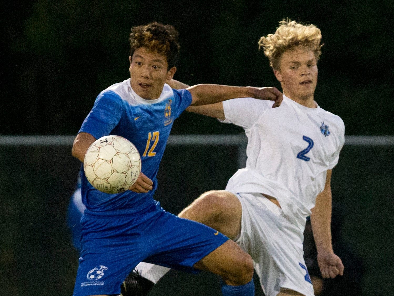 Germantown's Joshua Wu and Brookfield Central's Collin Heyden battle for the ball at Germantown on Sept. 13.