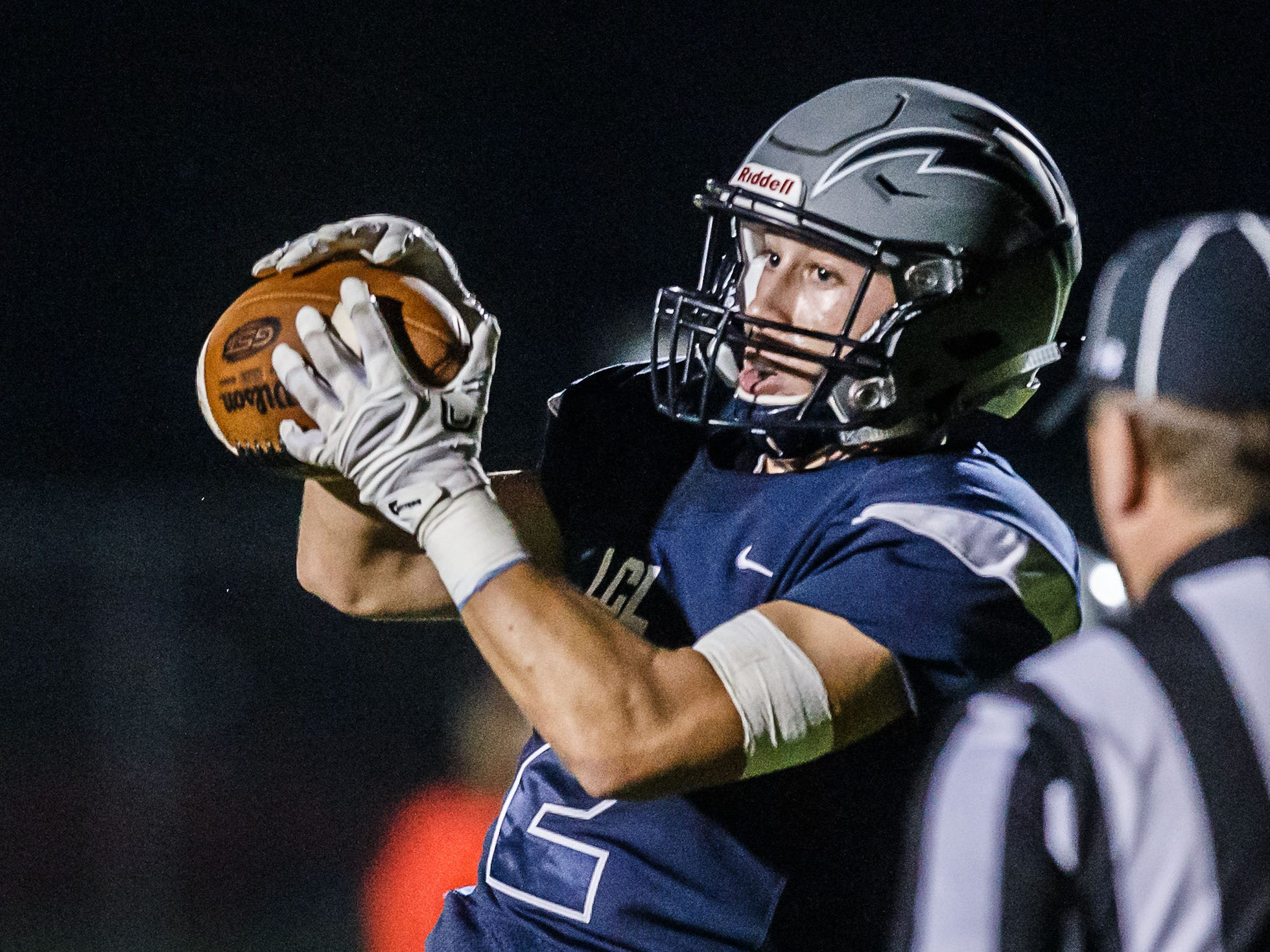 Lake Country Lutheran wide receiver Will Brazgel (2) pulls down a pass in the end zone during the game at home against University School of Milwaukee on Thursday, Sept. 13, 2018.