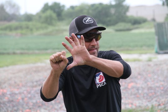 Brad Kidd discusses the relationship of the shot pattern to the clay pigeon during a coaching session at Waukesha Gun Club in Waukesha, Wisconsin.
