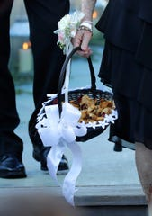 Dried rose petals were part of the wedding of Shelby Pecor and John Klein on Friday.