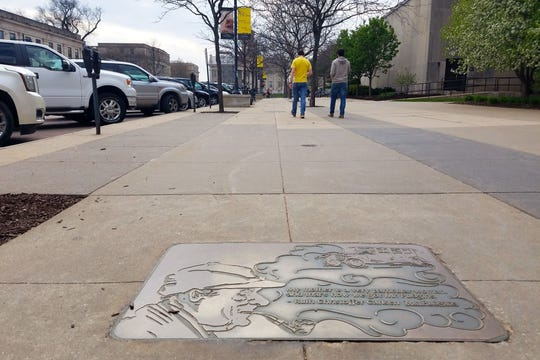 On a visit to Iowa City, stop in Prairie Lights Bookstore for a guide to the city's Literary Walk, bronze sidewalk panels that honor 49 writers associated with Iowa.