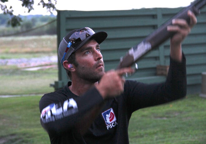 Brad Kidd of Stuart, Florida, a national champion in sporting clays who also works as a shotgun coach, demonstrates mounting and swinging a shotgun during a workshop at Waukesha Gun Club in Waukesha, Wisconsin.