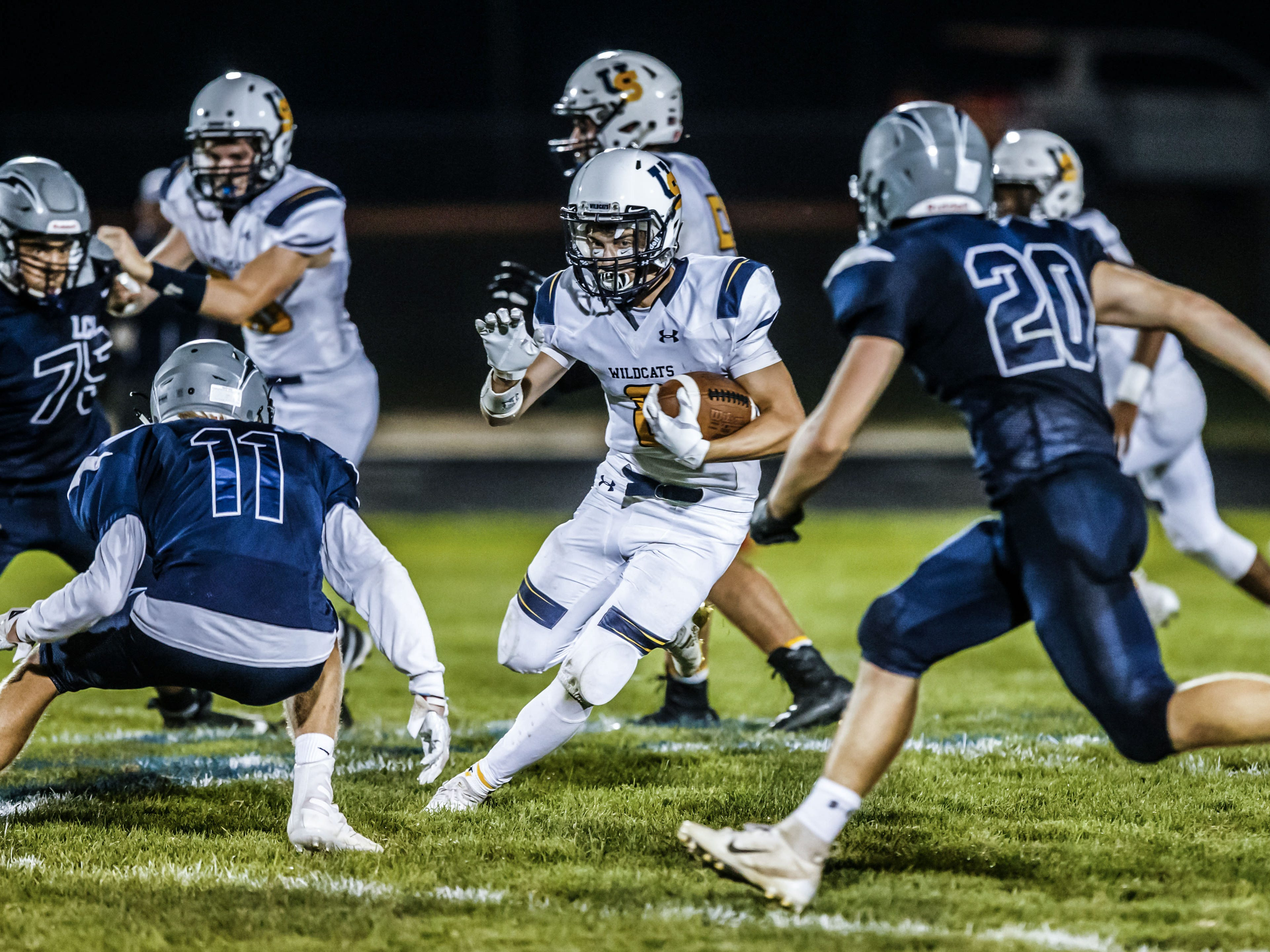 University School running back Gordy Leech (8) weaves through defenders during the game at Lake Country Lutheran on Thursday, Sept. 13, 2018.