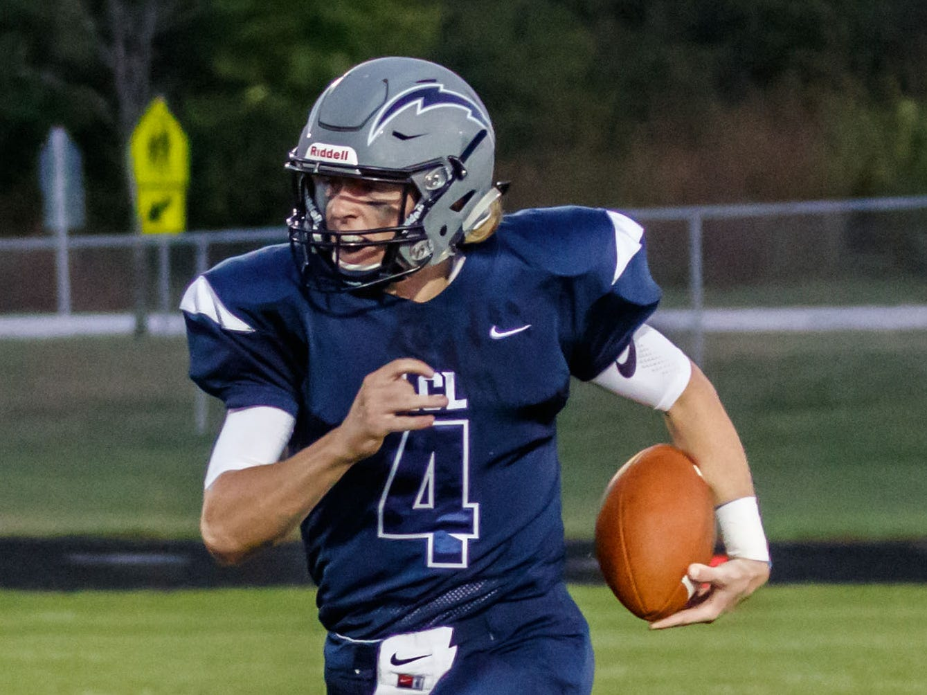 Lake Country Lutheran quarterback Ethan Wilkins (4) races for the corner during the game at home against University School of Milwaukee on Thursday, Sept. 13, 2018.