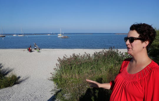 Milwaukee County Board Supervisor Marina Dimitrijevic looks over one of the proposed new beach locations at South Shore Park on the Lake Michigan shoreline. The county Parks Department has proposed moving the public beach to a new location with better water quality to avoid E. coli bacteria and reduce the number of summer beach closings.