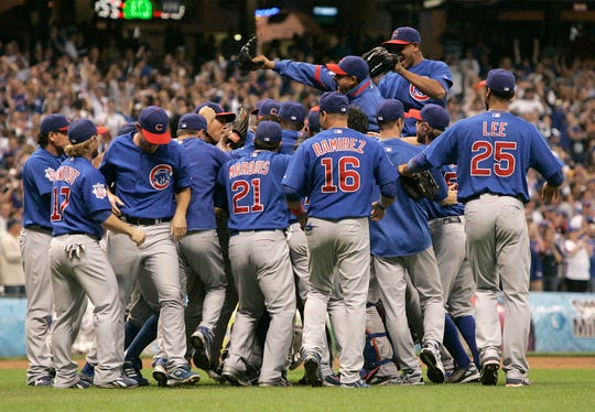 The Cubs rush the mound to celebrate Carlos Zambrano's no-hitter as the team rolls over the Houston Astros 5-0 at Miller Park on Sunday, Sept. 14, 2008.