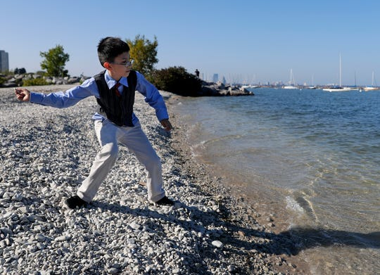 Christian Canales, 10, skips stones in Lake Michigan Thursday along one of the four proposed new beach locations in South Shore Park. The Milwaukee County Parks Department has proposed relocating the current beach because it is frequently closed due to bacterial contamination of the sand and water.