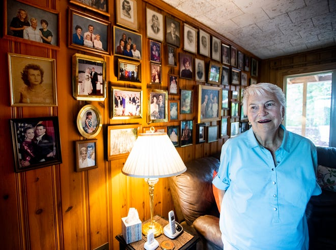 Dot Hawthorne stands by a wall of family photos at her home near Montgomery, Ala., on Friday September 14, 2018.