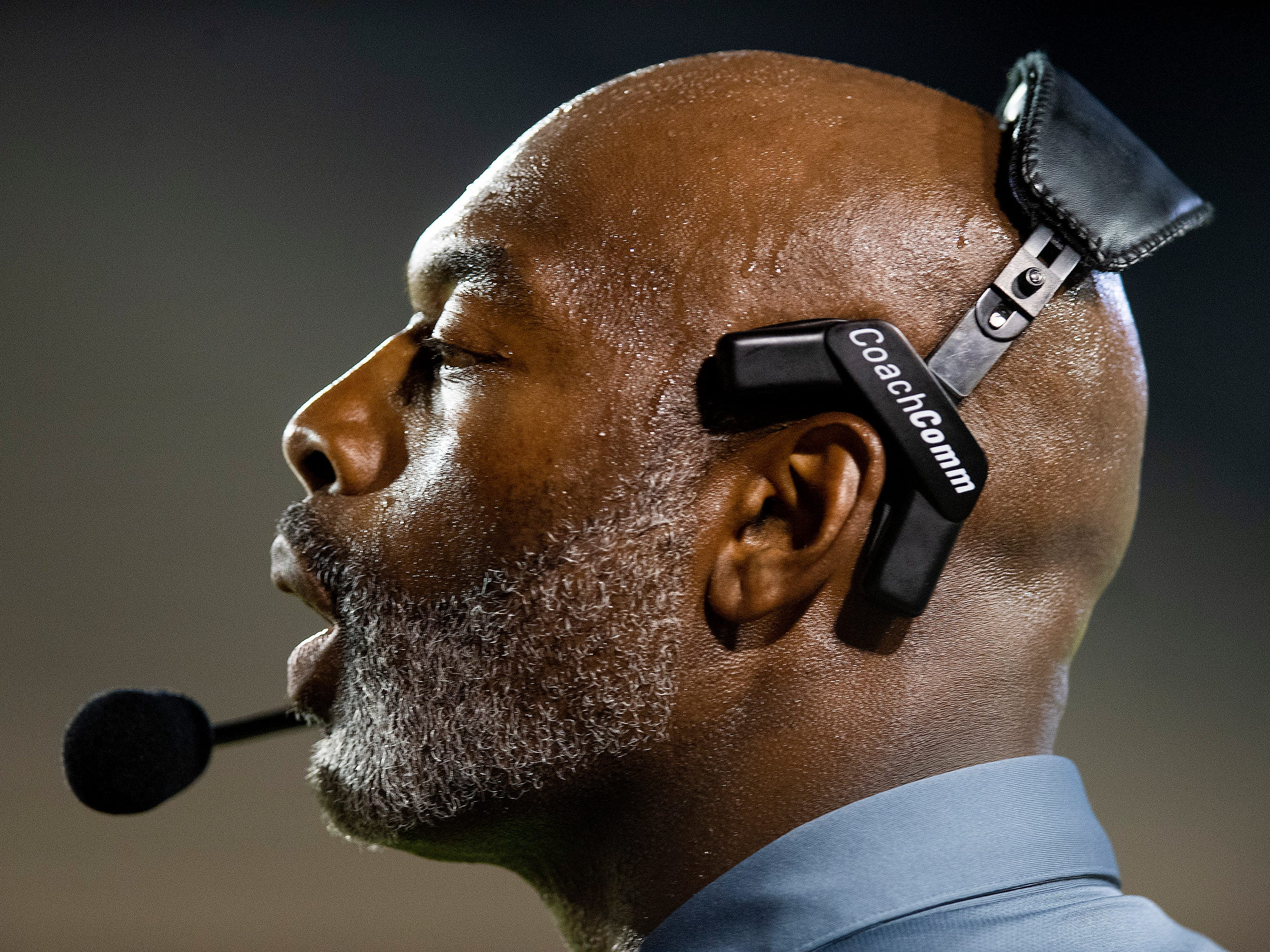 Lee coach Tyrone Rogers coaches against Auburn at Cramton Bowl in Montgomery, Ala., on Thursday September 13, 2018.