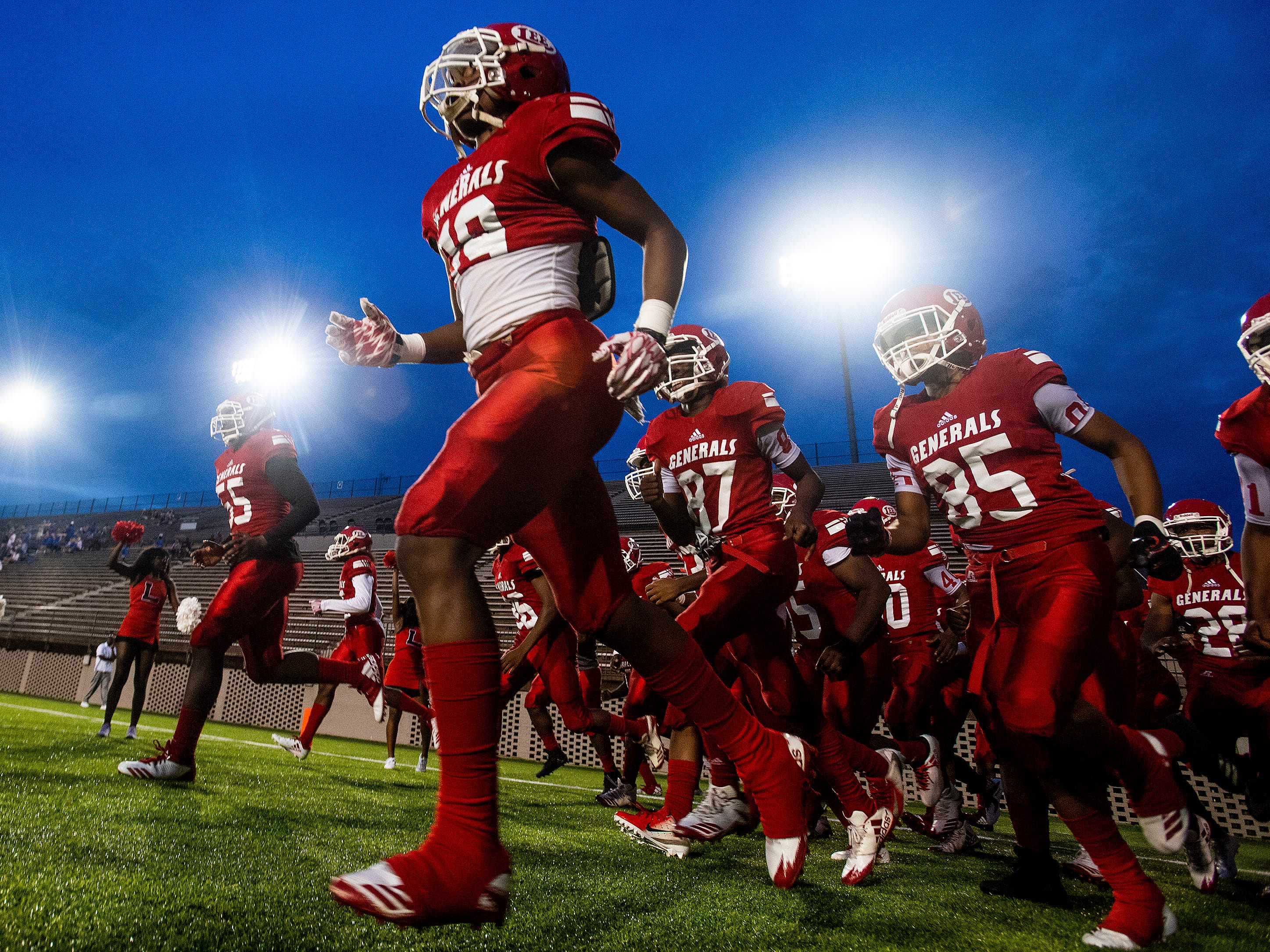 Lee players take the field against Auburn at Cramton Bowl in Montgomery, Ala., on Thursday September 13, 2018.