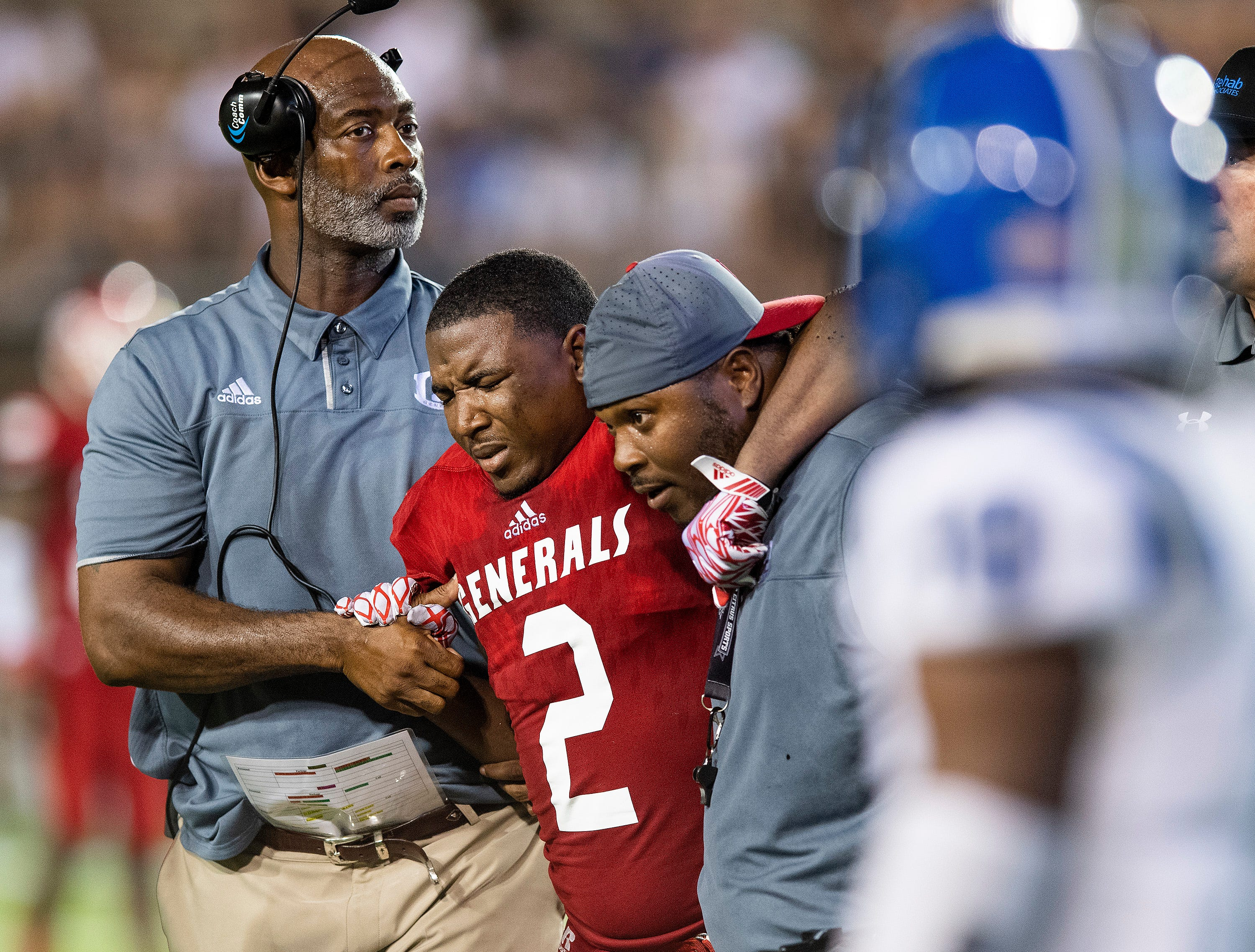 Lee's Landry Little is helped off the field after being injured against Auburn in first half action at Cramton Bowl in Montgomery, Ala., on Thursday September 13, 2018.