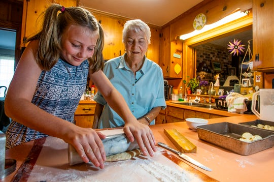 Dot Hawthorne makes bread with her granddaughter Carly Ellis at her home near Montgomery, Ala., on Friday September 14, 2018.