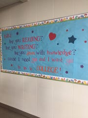 "A bulletin board at Boys and Girls Clubs of Wayne County holding updated, education-related lyrics to ""In My Feelings"" by Drake."