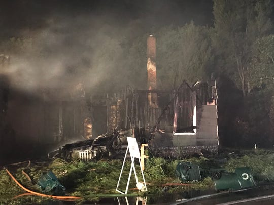 An early Friday fire destroyed one house in a neighborhood east of Central High School, seriously damaged another and forced the evacuation of a nearby apartment house.