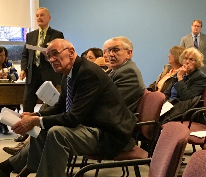 Emergency manager Steve Edwards (foreground); chief of staff John Williams (glasses); and financial officer Paul Pflederrer (standing) attend a Muncie school board meeting.