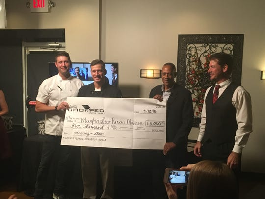 Winners of the second annual Charity Chopped in the 'Boro are, from left, Chef Alex Belew and Murfreesboro City Councilman Ronnie Martin, who are standing with Murfreesboro Rescue Mission Director Ed Grimes and event coordinator Shannon Wheeler.