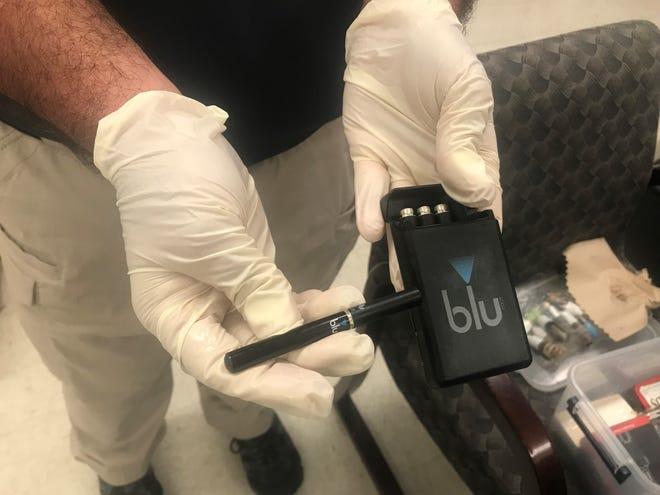 School Resource Officer Chris Gilmore holds a Blu electronic cigarette.