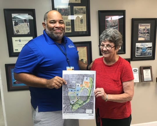 Scott Wallace, manager of sales and events at Fairgrounds Nashville, and Flea Market Manager Mary Ann Smith, show off a map of the redevelopment plan for the Fairgrounds.