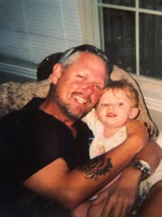 Cledus T. Judd and his daughter, Caitlyn, when she was 1