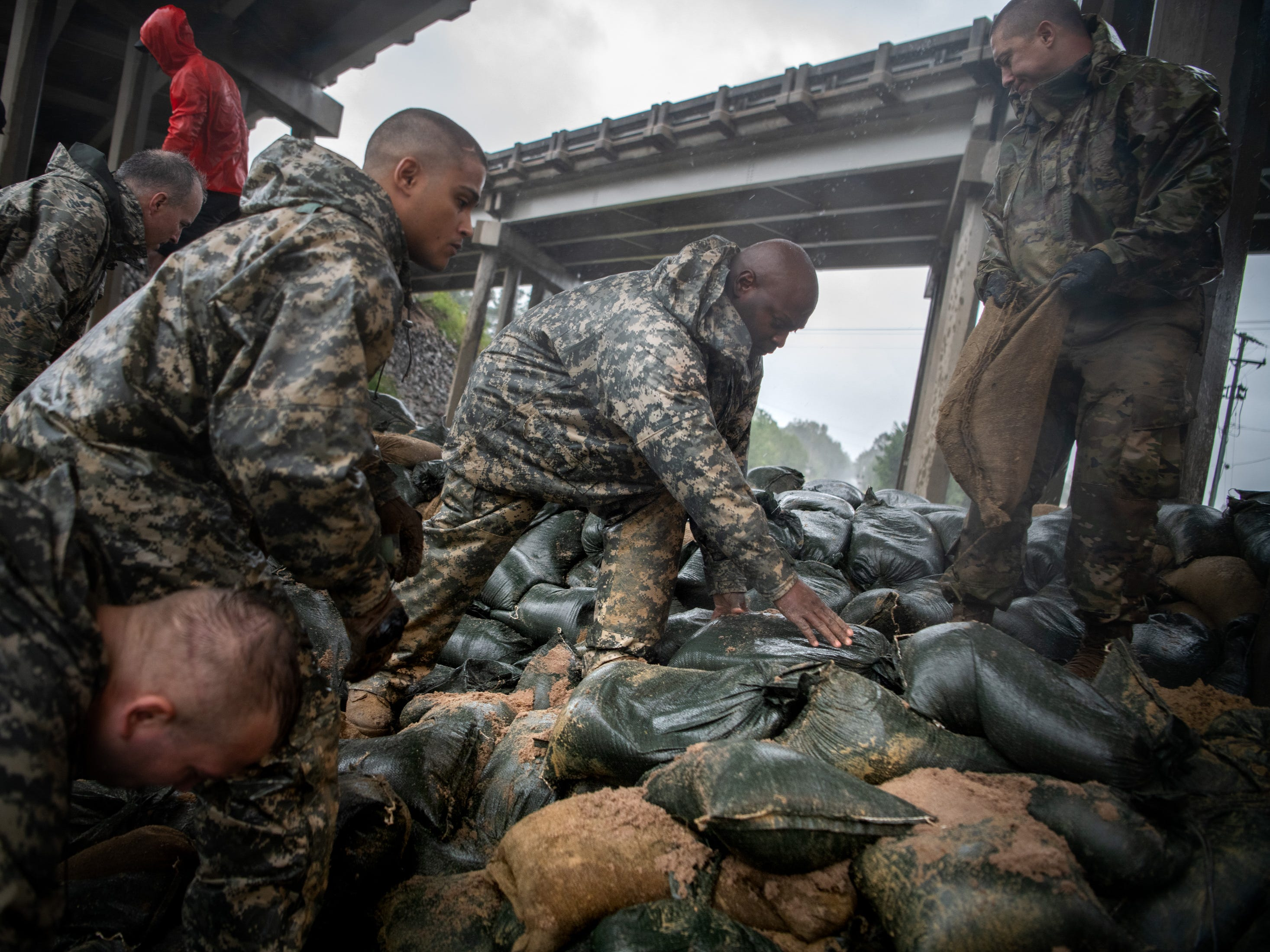 Soldiers from the North Carolina National Guard reinforce a low-lying area with sandbags as Hurricane Florence approaches Lumberton, N.C., Friday, Sept. 14, 2018.