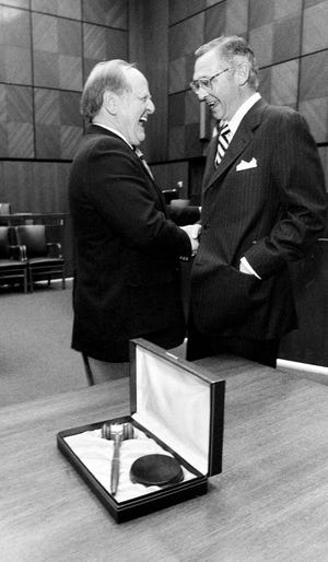 U.S. District Judge Thomas A. Higgins, right, is congratulated at his swearing-in-ceremony by Nashville attorney R.B. Parker on Dec. 3, 1984.