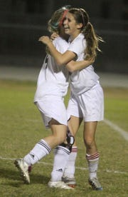 Mariner's Holly Fritz,right, celebrates with teammate Sarah Peer after Fritz scored the only goal to defeat Riverdale 1-0 Tuesday night 1/24/12 in a regional quarter final on Mariner's field in Cape Coral.