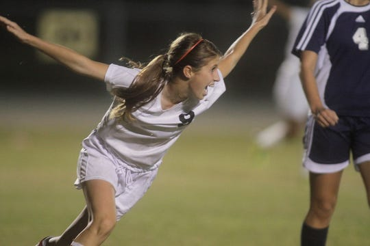 Mariner's Holly Fritz celebrates after scoring against Estero in the Region 3A-3 girls soccer semifinal at Mariner High School on Friday Jan. 27, 2012. Mariner won 2-1.