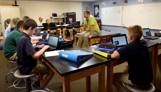 Granville Christian Academy teacher Brian Hassel leads a middle school science class.