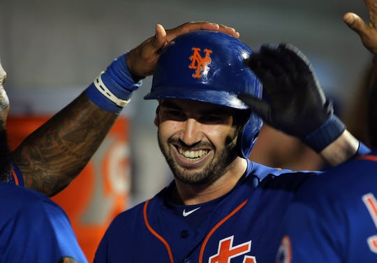Sep 13, 2018; New York City, NY, USA; New York Mets catcher Tomas Nido (3) is congratulated after hitting a solo home run against the Miami Marlins during the fifth inning during game two at Citi Field.