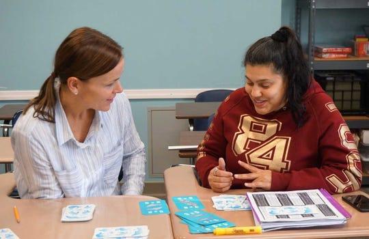 Volunteer Ann Kautzman tutoring Oasis GED student