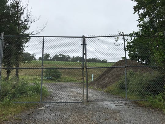 A gate at the Flora Avenue field complex in Hopatcong, N.J. separates athletic fields from the borough-owned landfill on Sept. 14, 2018.