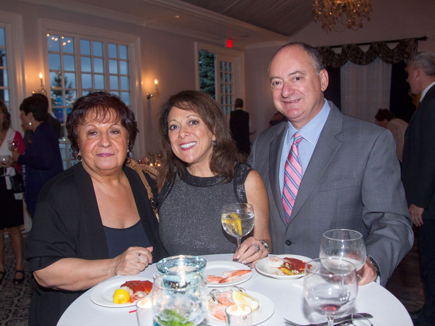 "Maddie Ceraul, Meryl Conte Clayton, John Conte Jr. Hackensack University Medical Center Foundation hosted ""Dance in to Ro's World,"" an evening to honor Rosemarie J. Sorce at the Stony Hill Inn in Hackensack. 09/13/2018"