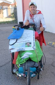 Superhero Adventure Man, armed with only a push cart, has covered over 2,500 miles of his projected 6,000-mile run across the United States. He has raised over $70,000 through five of 15 states he plans to run through for children's hospitals.