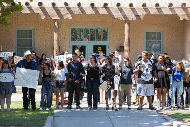 Students at Alma d'Arte charter school protest the termination of two staff, a teacher and a special education coordinator, along with some student expulsions, Friday September 14, 2018.