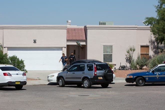 Las Cruces Police detective and officer leave the home on the 2400 block of Tiffany Drive, where Gary McKinney,47, was shot by an officer Thursday night. Friday September 14, 2018.