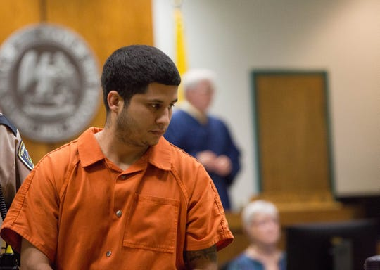 Lalo Anthony Castrillo IV is directed to his seat during a pre-trial detention hearing Friday, Sept. 14, 2018, in 3rd Judicial District Court.