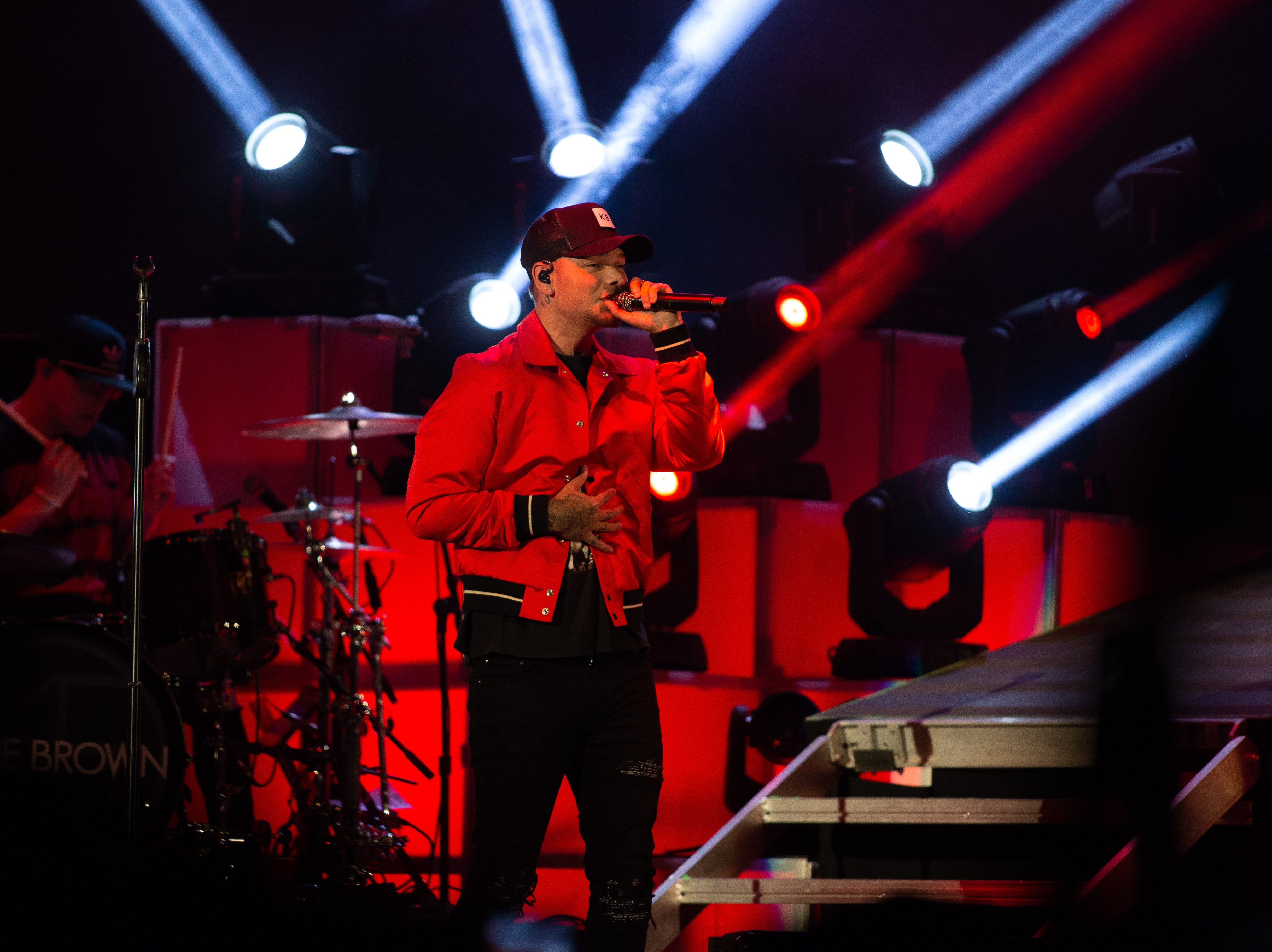 Kane Brown, wrapped in red light, was the second act during the Chris Young concert held at the Pan Am Center in Las Cruces on Thursday, Sept. 13, 2018.